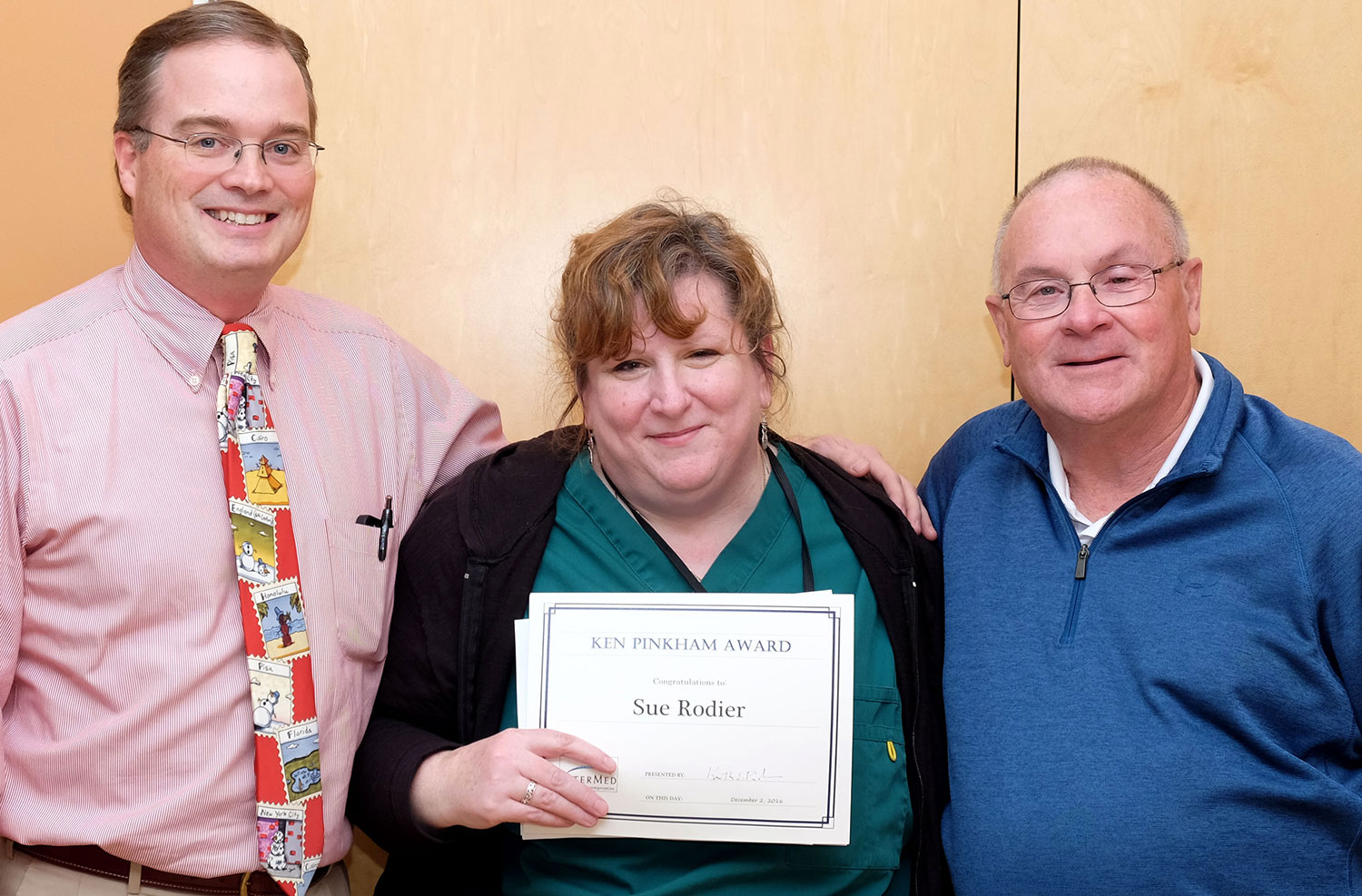 Sue Rodier of Internal Medicine poses with Randy Barr, M.D., left, and Ken Pinkham, after receiving the 2016 Ken Pinkham Award.